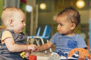Babys playing together in kindergarten.