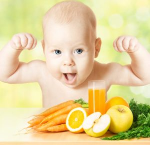 Baby with, fresh fruit meal and juice glass.